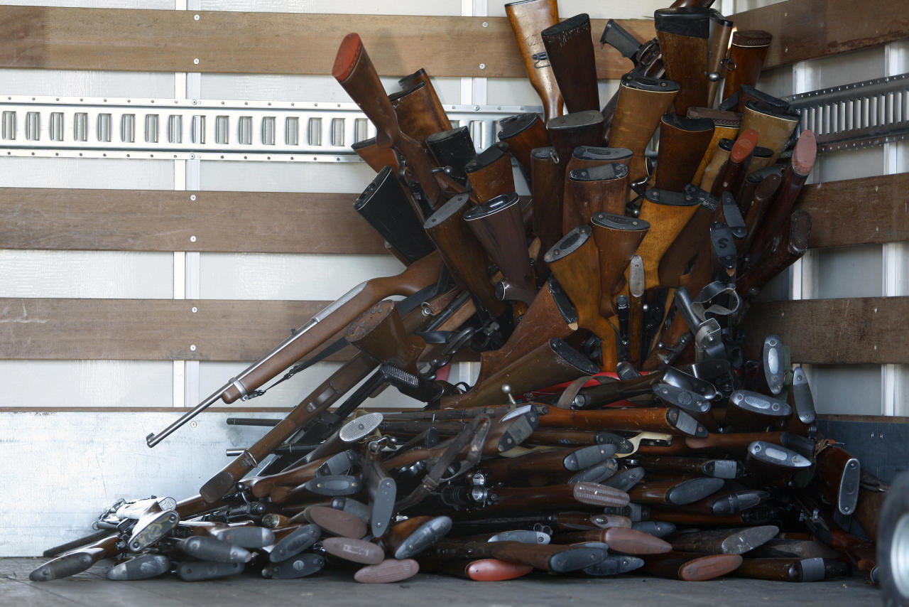 A small portion of guns that were turned in by their owners are stacked inside a truck at a gun buyback held by the Los Angeles Police Department  in Los Angeles, California, December 26, 2012 following the mass shooting at Sandy Hook Elementary School in Connecticut. The program normally occurs in May but Los Angeles mayor Antonio Villaraigosa accelerated the schedule in response to the December 14 shooting that left 20 children and six adults dead, along with the gunman, and caused a national outcry against gun violence. People can anonymously trade in their guns, no questions asked, for $200 grocery store gift cards for automatic weapons and $100 gift cards for shotguns, handguns and rifles.  REUTERS/David McNew  (UNITED STATES - Tags: CRIME LAW SOCIETY)