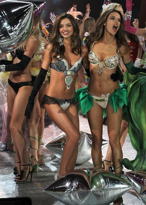 Victoria's Secret Angels Miranda Kerr (L) and Alessandra Ambrosio walk the runway during the 2012 Victoria's Secret Fashion Show