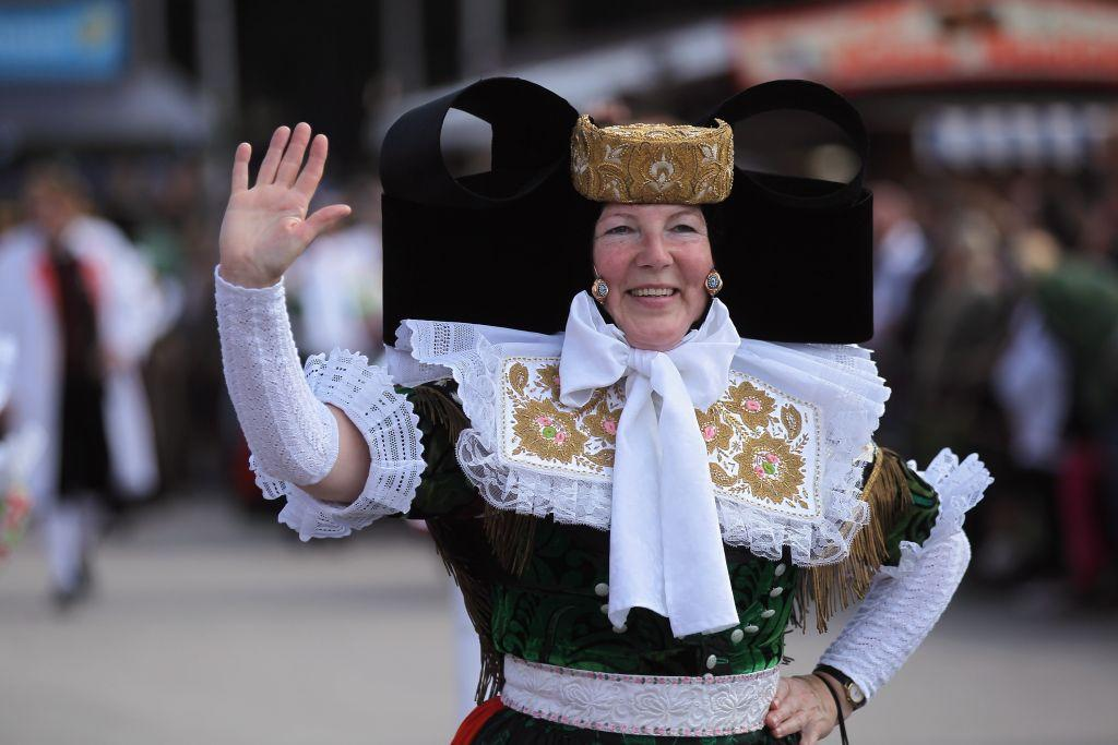 A woman dressed in a Northern German costume participates in the riflemen's parade.
