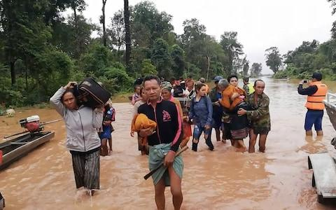 People evacuating flooded villages. Many have attempted to board safety boats to take them to safe areas