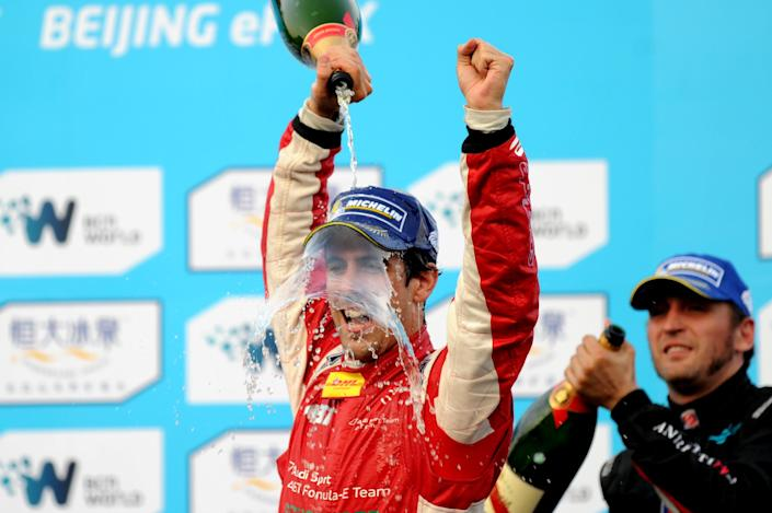 Lucas di Grassi of Brazil (left) celebrates after winning the Formula E race at the circuit near the Bird's Nest stadium in Beijing on September 13, 2014 (AFP Photo/Wang Zhao)