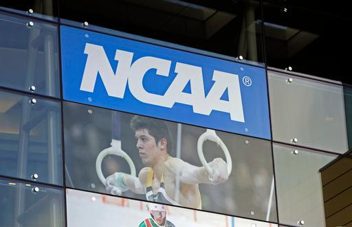 FILE - In this April 25, 2018, file photo, the NCAA headquarters is shown in Indianapolis. The NCAA and the Power Five conferences will have to work harder to prevent major changes to college sports now that Democrats control Congress and the White House. (AP Photo/Darron Cummings, File)