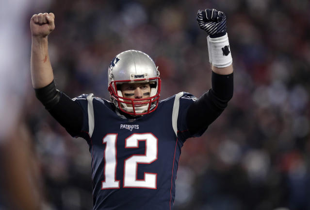 New England Patriots quarterback Tom Brady celebrates a touchdown against the Titans. (AP)