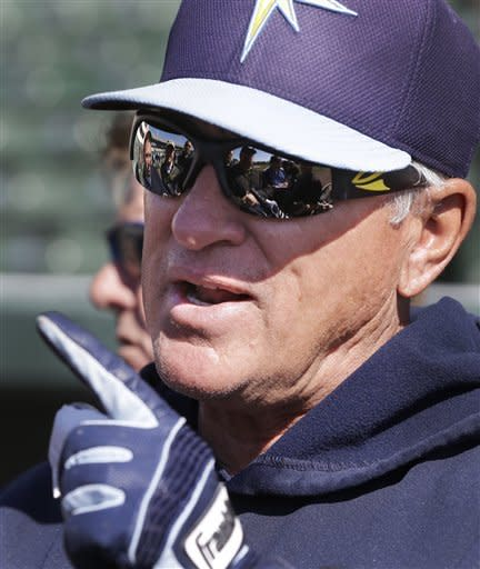 Tampa Bay Rays manager Joe Maddon addresses the media before an exhibition spring training baseball game against the Baltimore Orioles, Thursday, March 14, 2013 in Sarasota, Fla. (AP Photo/Carlos Osorio)