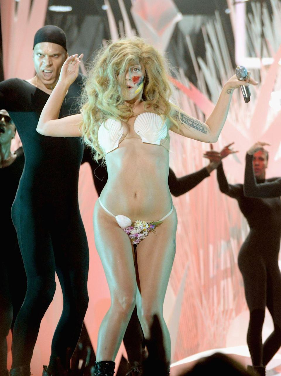 <p>Just when you thought Lady Gaga couldn't wear anything more outrageous, she rocked up at the 2013 VMAs dressed in nothing more than a few shells.</p>