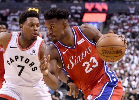 May 12, 2019; Toronto, Ontario, CAN; Philadelphia 76ers guard Jimmy Butler (23) dribbles the ball against Toronto Raptors guard Kyle Lowry (7) in game seven of the second round of the 2019 NBA Playoffs at Scotiabank Arena. Mandatory Credit: Dan Hamilton-USA TODAY Sports