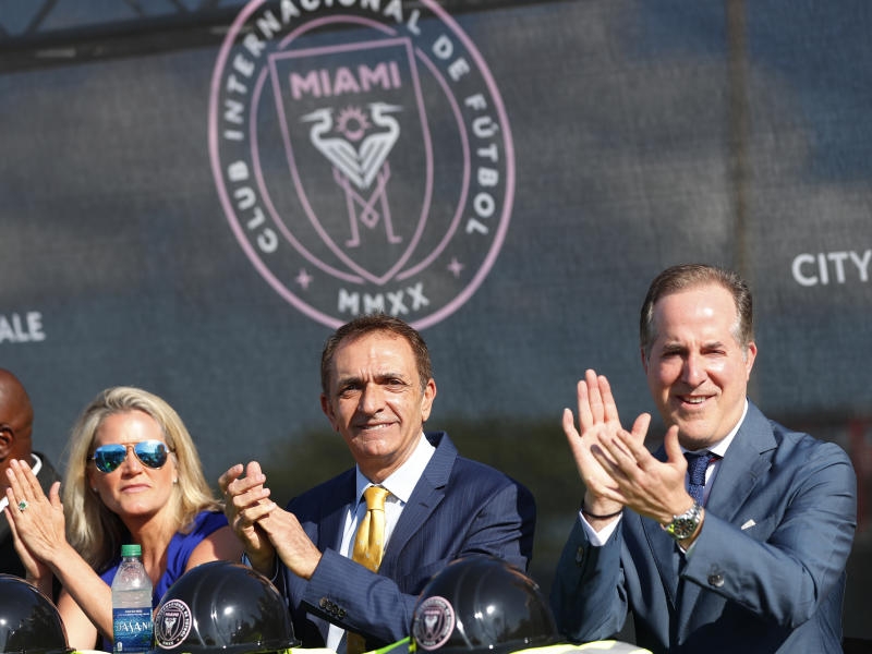 Fort Lauderdale Mayor Dean Trantalis, center, is flanked by city commissioner Heather Moraitis, left, and Inter Miami CF majority owner Jorge Mas as they applaud during ceremonies before the demolition of Lockhart Stadium, Wednesday, May 8, 2019, in Fort Lauderdale. A new stadium will be built at that site and will serve as the temporary home for Inter Miami CF while its permanent stadium is built at Freedom Park in Miami. (AP Photo/Wilfredo Lee)