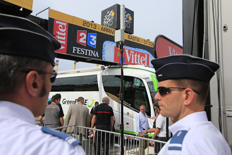 French gendarmes keep spectators away after the Orica Greenedge cycling team bus got stuck on the finish line of the first stage of the Tour de France cycling race over 213 kilometers (133 miles) with start in Porto Vecchio and finish in Bastia, Corsica island, France, Saturday June 29, 2013. (AP Photo/Peter Dejong)