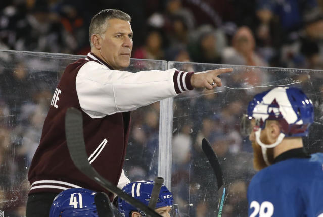 Colorado Avalanche coach Jared Bednar directs his team against the Los Angeles Kings during the first period of an NHL hockey game Saturday, Feb. 15, 2020, at Air Force Academy, Colo. (AP Photo/David Zalubowski)