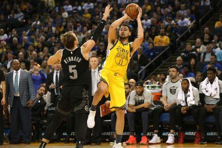 Mar 24, 2019; Oakland, CA, USA; Golden State Warriors guard Klay Thompson (11) shoots over Detroit Pistons guard Luke Kennard (5) in the fourth quarter at Oracle Arena. Mandatory Credit: Cary Edmondson-USA TODAY Sports