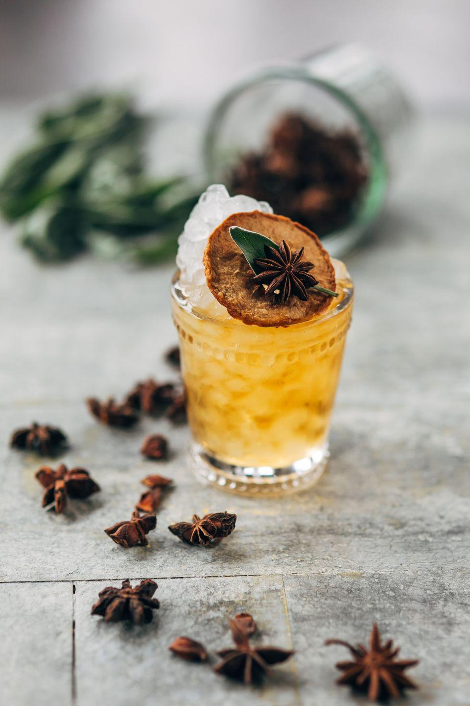 """<p>This unique combination of apple cider, carrot juice and absinthe is the perfect starter for an autumn dinner party.</p><p><strong>Ingredients:</strong><br></p><p>1 .25 oz. <a href=""""https://drizly.com/liquor/whiskey/scotch-whisky/johnnie-walker-red-label/p5175"""" rel=""""nofollow noopener"""" target=""""_blank"""" data-ylk=""""slk:Johnnie Walker Red"""" class=""""link rapid-noclick-resp"""">Johnnie Walker Red<br></a>1 oz. Unfiltered apple cider<br>.5 oz. Fresh carrot juice<br>.5 oz. Sage/Ginger syrup<br>.2 oz. Absinthe<br>.25 oz. Apple cider vinegar<br>Crushed ice</p><p><strong>Directions:</strong></p><p>Build all ingredients into a rocks glass over ice.</p>"""