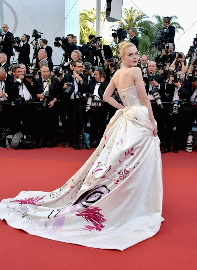 <p>Elle Fanning's custom gown featured a hand-painted unicorn on the massive train. (Photo: Getty Images) </p>