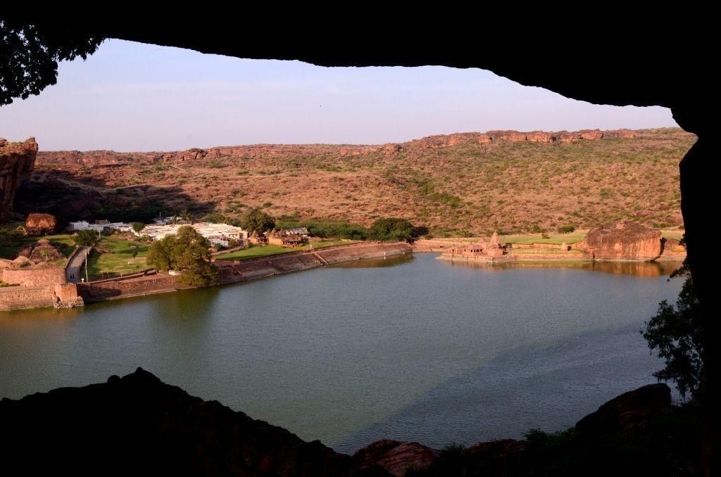 <b>1.	Badami, Karnataka </b><br><br>Towering sandstone cliffs glow in the evening light as the craggy hillocks surround you, dwarfing you to a tiny speck. Badami is strictly not just for heritage buffs, even though you go back in time in this ancient Chalukyan capital, Vatapi, where sculptors carved on rock-cut caves and created a montage of deities in stone. The emerald-hued Agasthya Teertham flows in the town and is bordered by several temples. Badami was fortified and a walk up to the Shivalaya is one of the best experiences as you trudge along the path of the ancient Chalukyans who built these temples atop the hills.