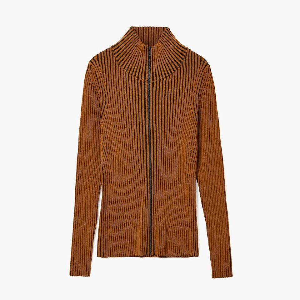 """$135, COS STORES. <a href=""""https://www.cosstores.com/en_usd/women/womenswear/coats-and-jackets/jackets/product.ribbed-knitted-zip-up-jacket-yellow.0924905002.html"""" rel=""""nofollow noopener"""" target=""""_blank"""" data-ylk=""""slk:Get it now!"""" class=""""link rapid-noclick-resp"""">Get it now!</a>"""