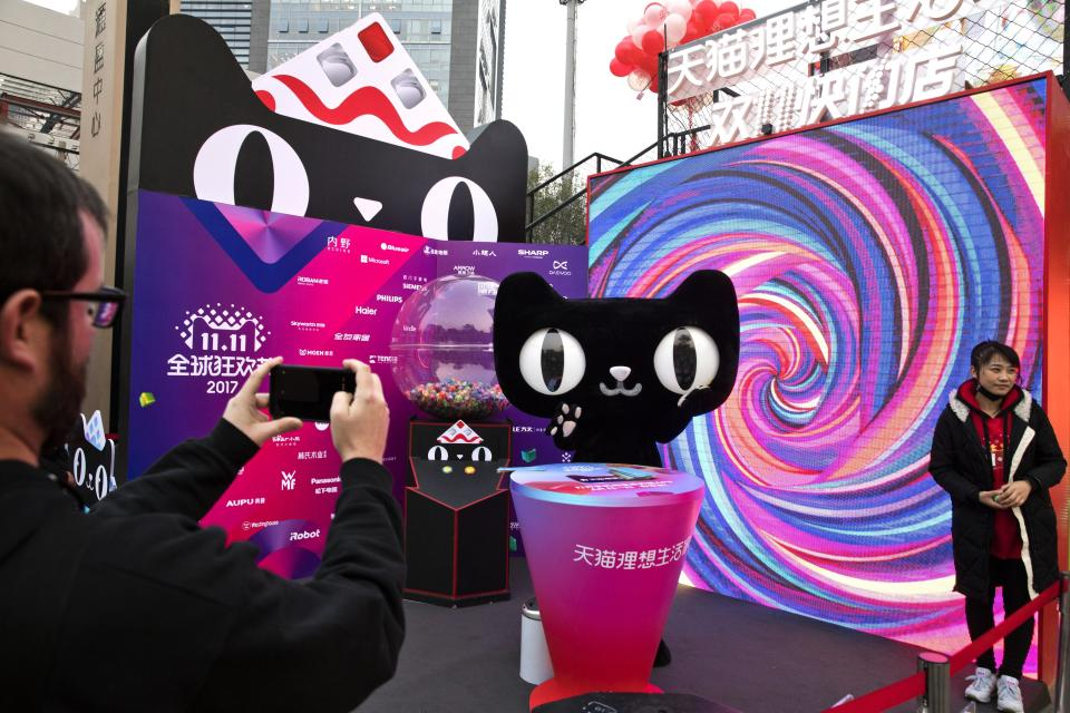 "A mascot for Tmall, an online shopping website owned by Alibaba, promotes Singles Day in Beijing, China, Monday, Nov. 6, 2017. On Nov. 11, online shoppers are expected to spend billions of dollars on ""Singles' Day,"" a quirky holiday that has grown into the world's busiest day for e-commerce. (AP Photo/Ng Han Guan)"