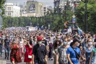 People march during an unsanctioned protest in support of Sergei Furgal, the governor of the Khabarovsk region, in Khabarovsk, 6100 kilometers (3800 miles) east of Moscow, Russia, Saturday, July 18, 2020. Tens of thousands of people in the Russian Far East city of Khabarovsk took to the streets on Saturday, protesting the arrest of the region's governor on charges of involvement in multiple murders. Local media estimated the rally in the city attracted from 15,000 to 50,000 people. (AP Photo/Igor Volkov)
