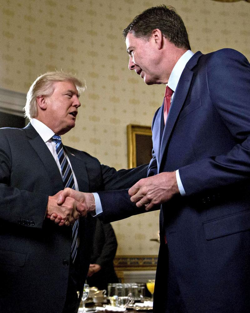 Donald Trump and James Comey in the Oval Office two days after the president's inauguration