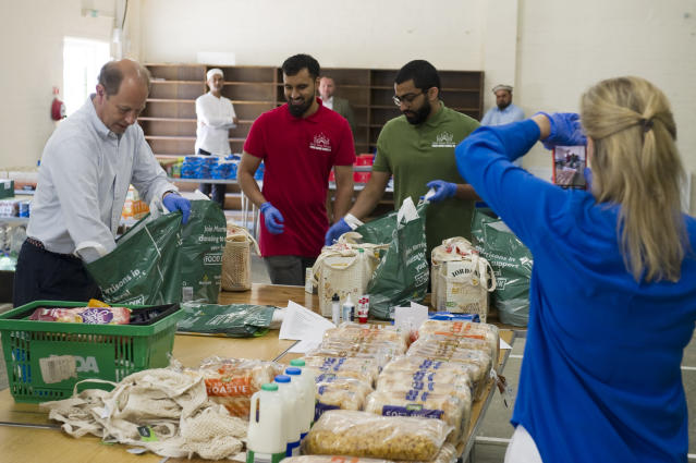 Sophie, the Countess of Wessex taking a picture of Ali (centre), a fellow volunteer organising food deliveries at the Shah Jahan Mosque, where she and Edward volunteered. (Buckingham Palace/PA Images)