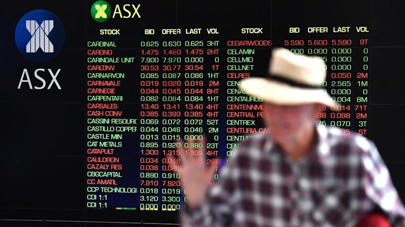 <p>Gains by bank and energy stocks have pushed the Australian share market higher at lunchtime.</p>