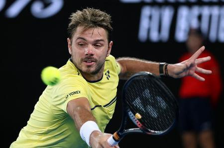FILE PHOTO: Tennis - Australian Open - Second Round - Melbourne Park, Melbourne, Australia, January 17, 2019. Switzerland's Stan Wawrinka in action during the match against Canada's Milos Raonic. REUTERS/Lucy Nicholson