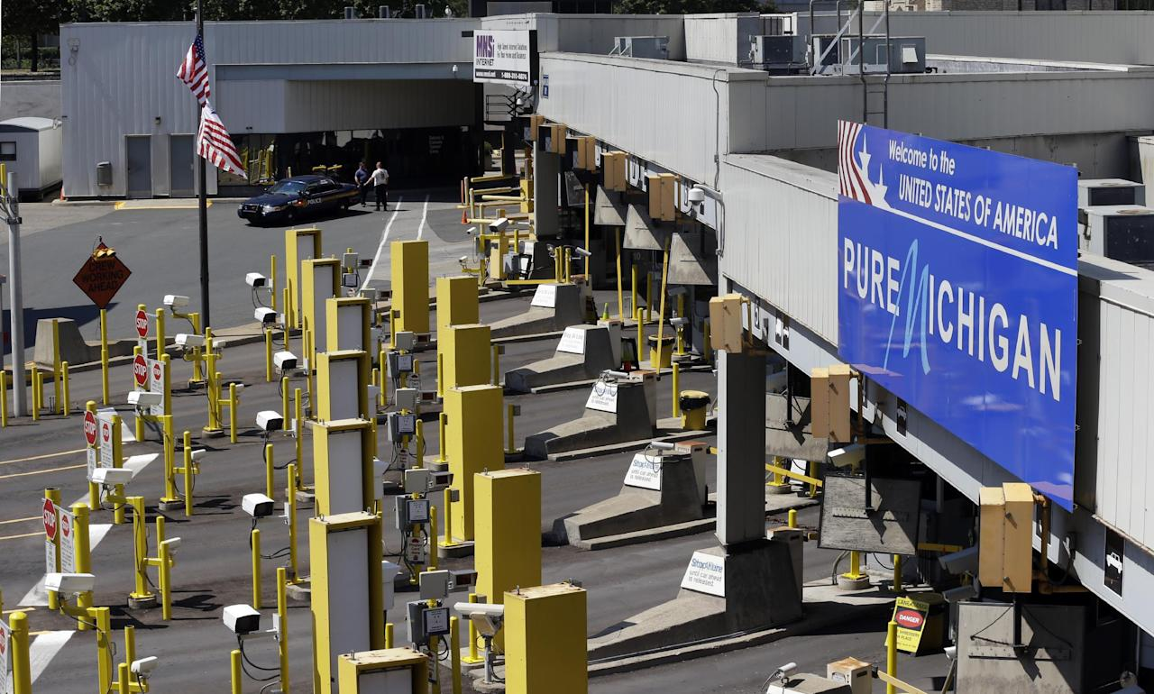 Lanes entering the United States are shown closed during an investigation of a bomb threat at the Detroit Windsor Tunnel Thursday, July 12, 2012. The tunnel was closed to traffic after the threat was called in on the Canadian side, tunnel chief executive Neal Belitsky told The Associated Press. The call was made some time after 12:30 p.m. to the duty free shop on a plaza on the tunnel's Windsor side, tunnel executive vice president Carolyn Brown said. (AP Photo/Paul Sancya)