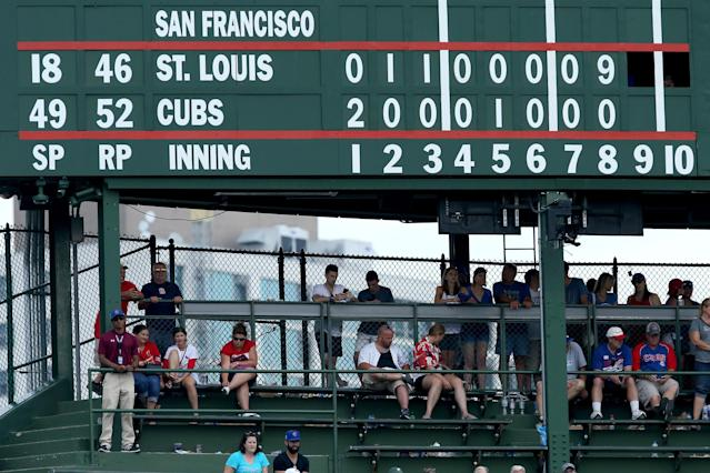 A 6-8 inch metal pin fell off the Wrigley Field scoreboard on Tuesday and injured a fan who was wearing a bucket on his head. (Photo by Dylan Buell/Getty Images)