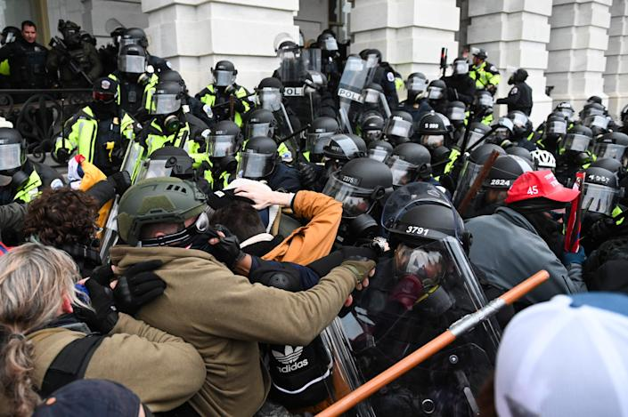 Riot police push back a crowd of Trump supporters storming the Capitol building on Jan. 6, 2021 in Washington, DC.