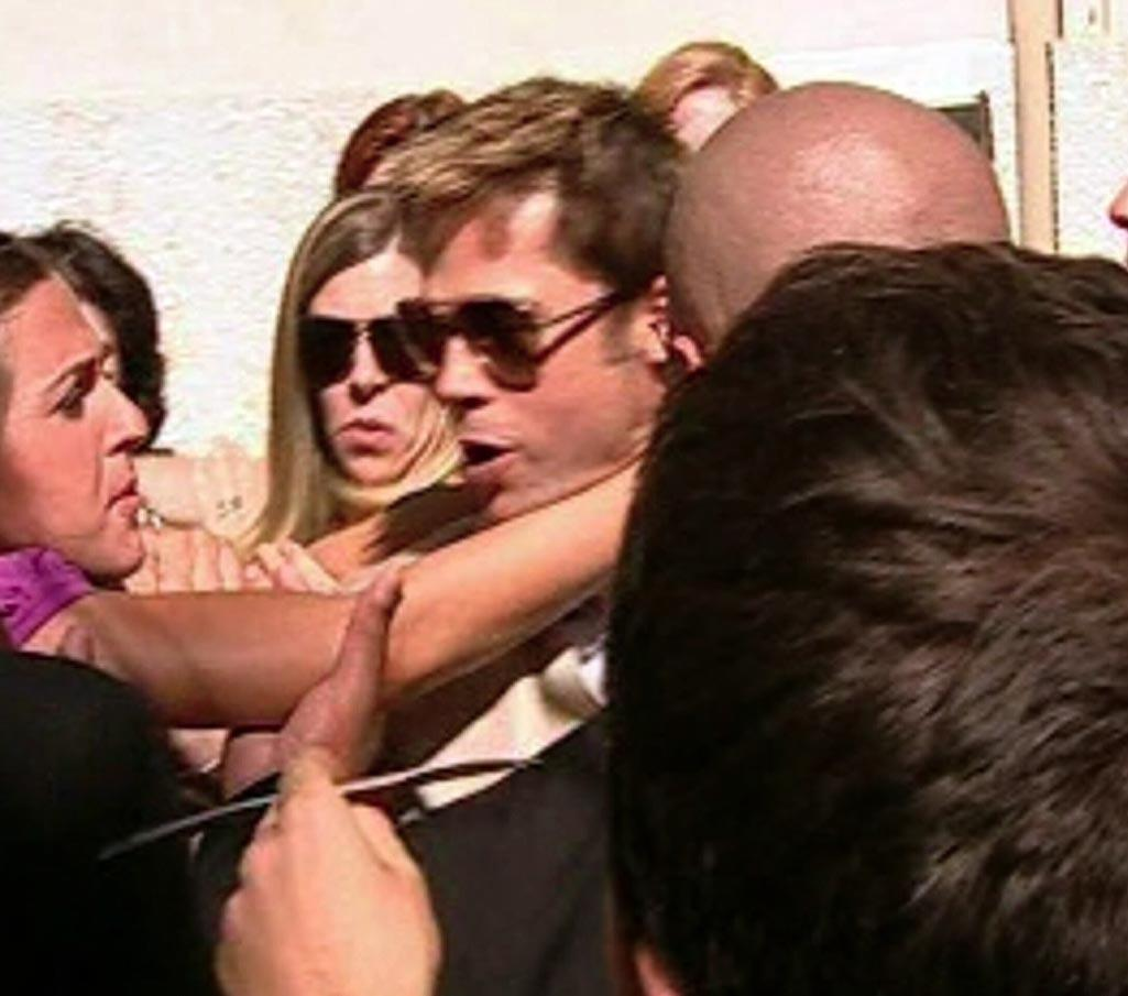 "An overzealous fan charged towards the superstar and wrapped her arms around his neck in an attempt to hug him. <a href=""http://www.splashnewsonline.com/"" target=""new"">Splash News</a> - September 3, 2007"