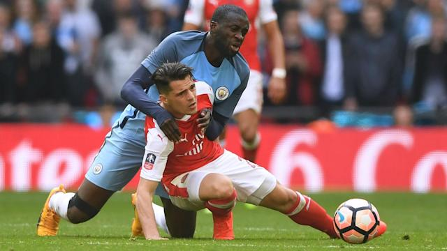 Manchester City midfielder Yaya Toure simmered over perceived refereeing injustice at Wembley and wants a response against United.