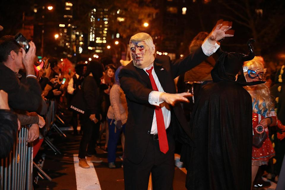 <p>A man wearing a President Trump mask walks like a zombie at the 44th annual Village Halloween Parade in New York City on Oct. 31, 2017. (Photo: Gordon Donovan/Yahoo News) </p>