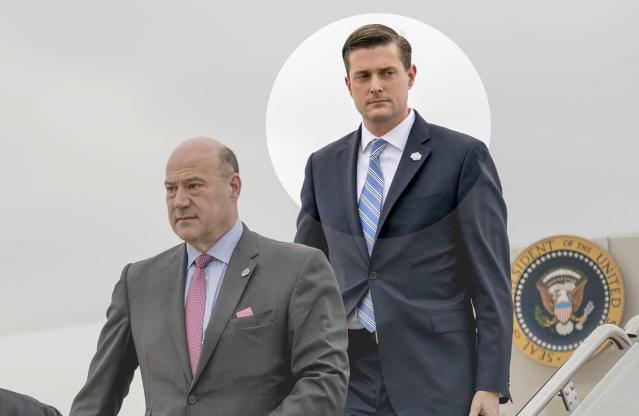 White House chief economic adviser Gary Cohn, left, and White House staff secretary Rob Porter, right, arrive at Andrews Air Force Base, Md., Thursday, Feb. 1, 2018, for a short trip to the White House after accompanying President Trump at the 2018 House and Senate Republican Member Conference at the Greenbrier resort in White Sulphur Springs, W.Va. (AP Photo)