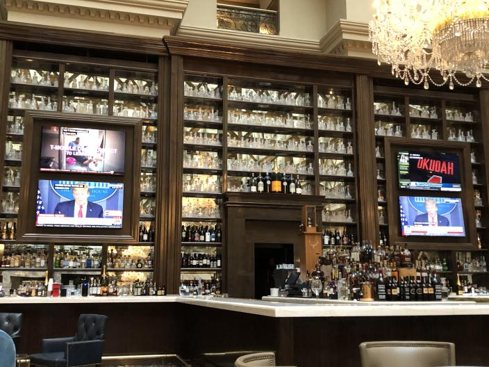 Televisions in the hotel's lobby showing President Trump speaking during a White House coronavirus task force briefing on April 22. (Sharon Weinberger/Yahoo News)