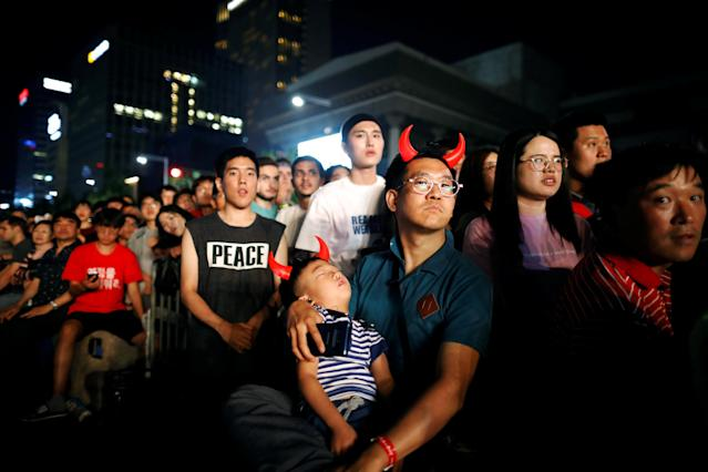 South Korean fans watch the broadcast of the World Cup Group F soccer match between Sweden and South Korea, in central Seoul, South Korea, June 18, 2018. REUTERS/Kim Hong-Ji