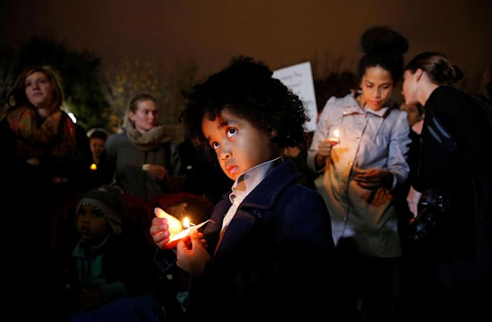 <p>A young boy stands with other anti-Trump demonstrators during a candlelight vigil in front of the White House in Washington on Nov. 9, 2016. (Photo: Kevin Lamarque/Reuters) </p>