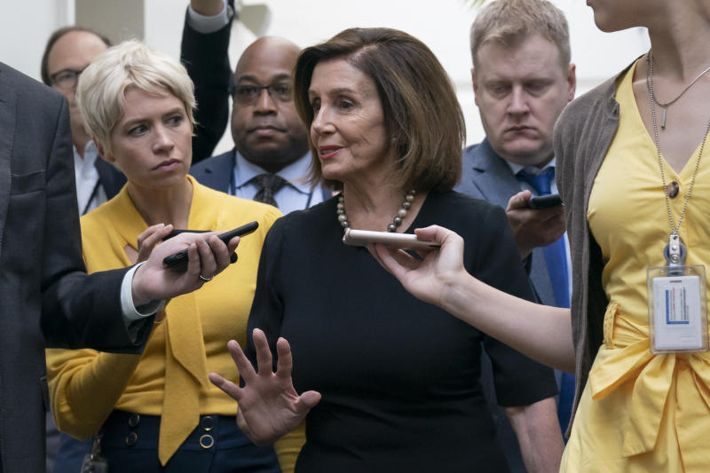 Speaker of the House Nancy Pelosi, D-Calif., is surrounded by reporters as she arrives to meet with her caucus the morning after declaring she will launch a formal impeachment inquiry against President Donald Trump, at the Capitol in Washington, Wednesday, Sept. 25, 2019. (AP Photo/J. Scott Applewhite)