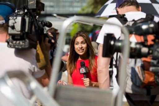 A television presenter records a piece to camera outside St Mary's Hospital in London, on July 17, 2013