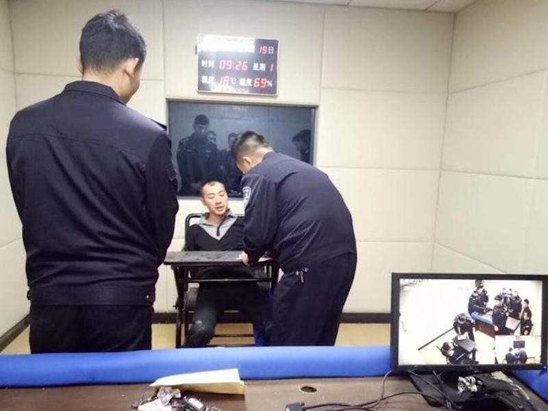 Chinese knifeman held for killing his parents, daughter; slashing six others during botched escape