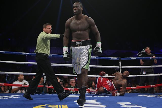 Deontay Wilder goes to a neutral corner after knocking down Malik Scott in March 2014. (AP)