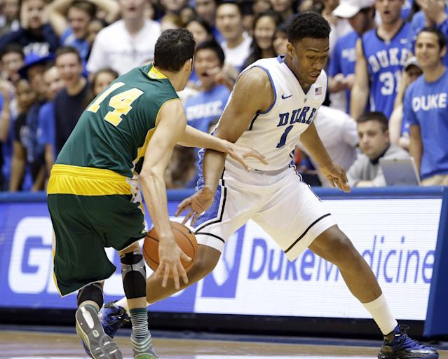 Duke's Jabari Parker (1) tries to steal the ball from Vermont's Josh Elbaum (14) during the first half of an NCAA college basketball game in Durham, N.C., Sunday, Nov. 24, 2013. (AP Photo/Gerry Broome)