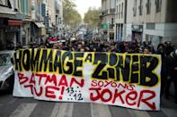 """Protestors hold a banner reading """"Tribute to Zineb. Batman kills, let's be the Joker"""" during a march in tribute to Zineb Redouane who died at the age of 80 in December 2018 after being hit by a police tear gas grenade"""