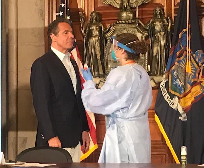 New York Gov. Andrew Cuomo gets ready for a coronavirus test during his daily coronavirus briefing at the state Capitol in Albany last May.