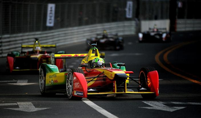 Audi Sport Abt Formula E Team driver Lucas di Grassi of Brazil takes a turn during the Formula E race at the circuit near the Bird's Nest stadium in Beijing on September 13, 2014 (AFP Photo/Wang Zhao)