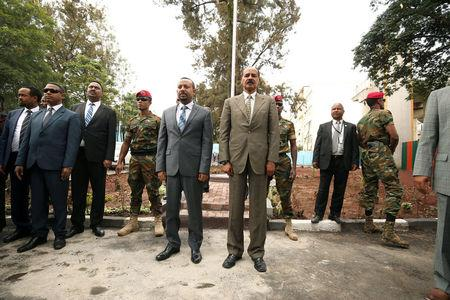 FILE PHOTO: Eritrea's President Isaias Afwerki and Ethiopia's Prime Minister, Abiy Ahmed during the national anthem at the Inauguration ceremony marking the reopening of the Eritrean Embassy in Addis Ababa