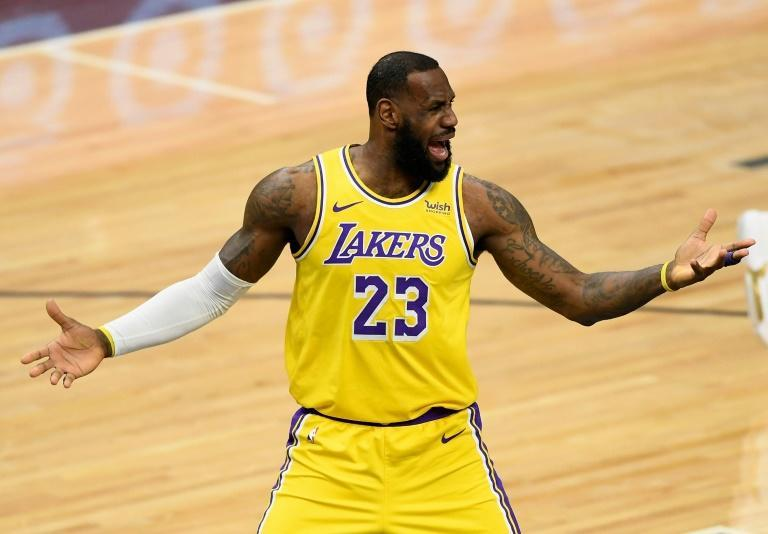 Los Angeles Lakers LeBron James waives his arms during the first quarter of the game against the Minnesota Timberwolves at Target Center