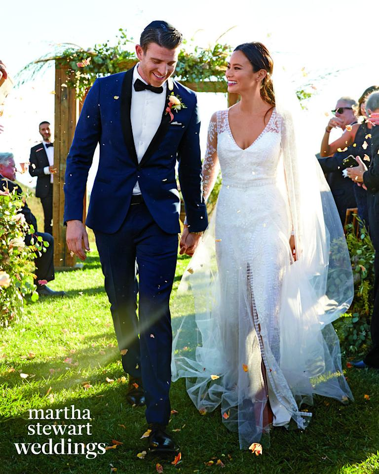 """<p>We saw <a href=""""https://www.yahoo.com/style/jamie-chung-married-bryan-greenberg-got-married-on-185749007.html"""">some fuzzy photos</a> of actress Jamie Chung's silk and tulle Monique Lhuillier wedding gownwedding gown back when she first married Bryan Greenberg this past Halloween — but the latest issue of <i>Martha Stewart Weddings</i>has now gifted us with a much sweeter HD view! The bride had her hair pulled back in a low ponytail, while her husband sported a blue and black tux. Not content to wear just one dress (what bride is, these days?), the new Mrs. Greenberg chose to also wear a <a href=""""http://media1.popsugar-assets.com/files/2016/02/23/687/n/1922398/1fd4b6e1bfecd258_cover_W0316rlji0A.xxxlarge/i/Jamie-wearing-her-Jonathan-Simkhai-dress.jpg"""">flouncy, high-necked frock by Jonathan Simkhai</a>for both the photos before the ceremony and the reception afterwards. Hey, it never hurts to have multiple options available!<i> (Photo:<a href=""""http://www.marthastewartweddings.com/node/409786/jamie-chung-bryan-greenberg-wedding-photos?socsrc=press"""">Martha Stewart Weddings / Thayer Allyson Gowdy</a>)</i><br /></p>"""