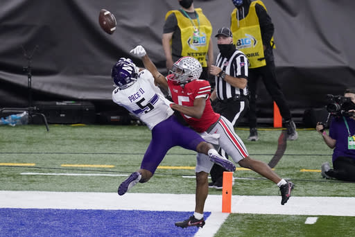 Ohio State wide receiver Garrett Wilson, right, is unable to reach a pass as Northwestern defensive back JR Pace defends during the second half of the Big Ten championship NCAA college football game, Saturday, Dec. 19, 2020, in Indianapolis. (AP Photo/Darron Cummings)