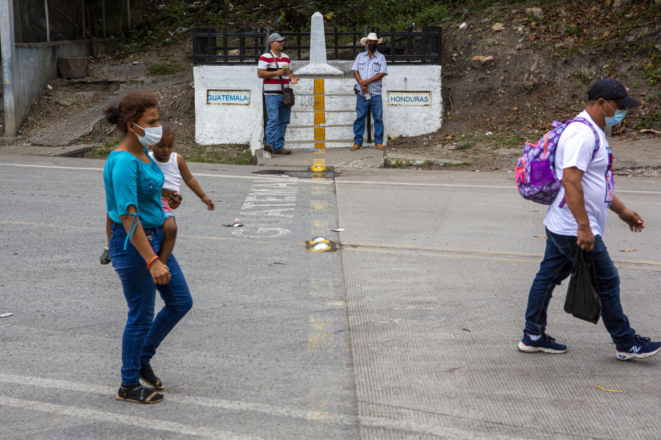 Honduran migrants return to their country of origin at the border crossing in El Florido, Guatemala, Tuesday, Jan. 19, 2021. A once large caravan of Honduran migrants that pushed its way into Guatemala last week had dissipated by Tuesday in the face of Guatemalan security forces. (AP Photo/Oliver de Ros)