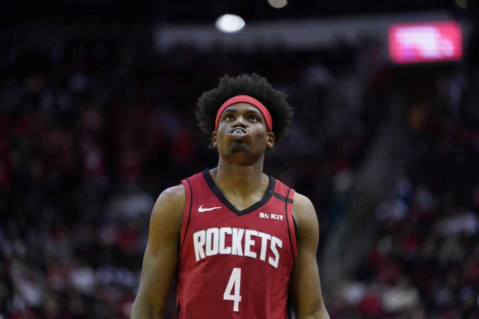 Houston Rockets' Danuel House Jr. (4) looks up at the scoreboard during the second half of an NBA basketball game against the Los Angeles Clippers Thursday, March 5, 2020, in Houston. (AP Photo/David J. Phillip)