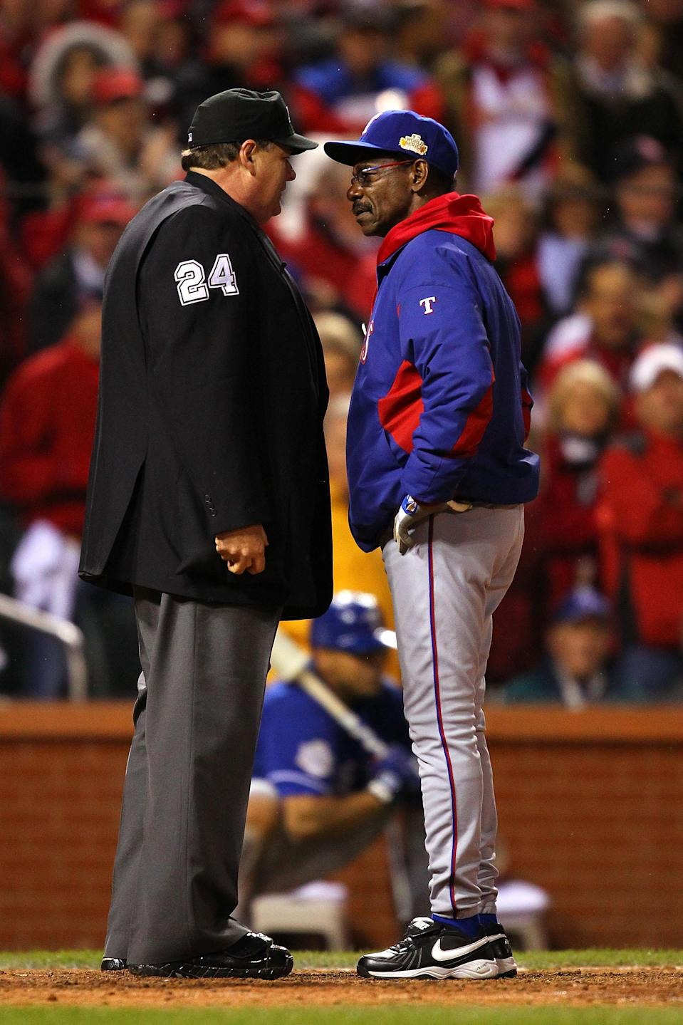 ST LOUIS, MO - OCTOBER 19: Manager Ron Washington of the Texas Rangers argues a call with home plate umpire Jerry Layne after Adrian Beltre #29 was called out on a disputed call in the ninth inning during Game One of the MLB World Series against the St. Louis Cardinals at Busch Stadium on October 19, 2011 in St Louis, Missouri. The Cardinals won 3-2. (Photo by Dilip Vishwanat/Getty Images)