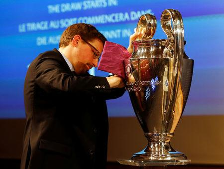 A UEFA staff member cleans the Champions League trophy before the draw of the quarterfinals in Nyon, Switzerland March 17, 2017. REUTERS/Denis Balibouse